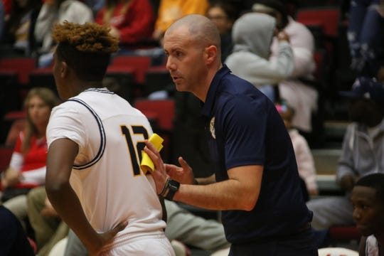 Northeast boys basketball coach John Stigall gives instructions to his players during the Montgomery County Basketball Jamboree Thursday at Austin Peay's Dunn Center.