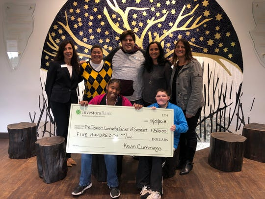 The Shimon and Sara Birnbaum Jewish Community Center (JCC) in Bridgewater recently received a grant from Investors Foundation in support of JCC Special Needs programs. Pictured are (left to right): JCares Interns Nikki and Matt (seated);  Standing are Antonella Celli, assistant vice president branch manager Investors Bank, Pluckemin Branch; Ellie Willoughby, JCC Special Services director; Rob Demeter, JCares mentor; Laura Friedman, JCC executive director and Paige Silberfein, JCC associate executive director.