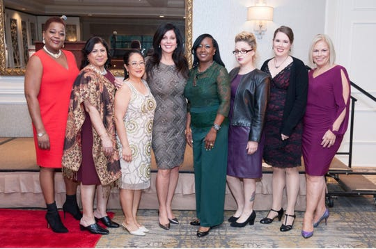 Success Ambassadors who have found employment after graduating from a Dress for Success workforce development program pose with DFSCNJ Executive Director Melissa Tenzer (4th from left) and Designing Your Future program manager, Nancy Musco (far right).