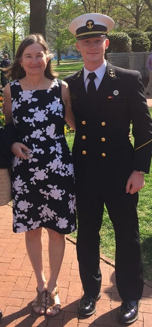 Dr. Siobhan Corbett, associate professor of surgery at Rutgers Robert Wood Johnson Medical School, was one of the instructors in the technical portion of the medical school's recent training for medics. She is pictured with her son, Jay, who is a midshipman in the U.S. Naval Academy.