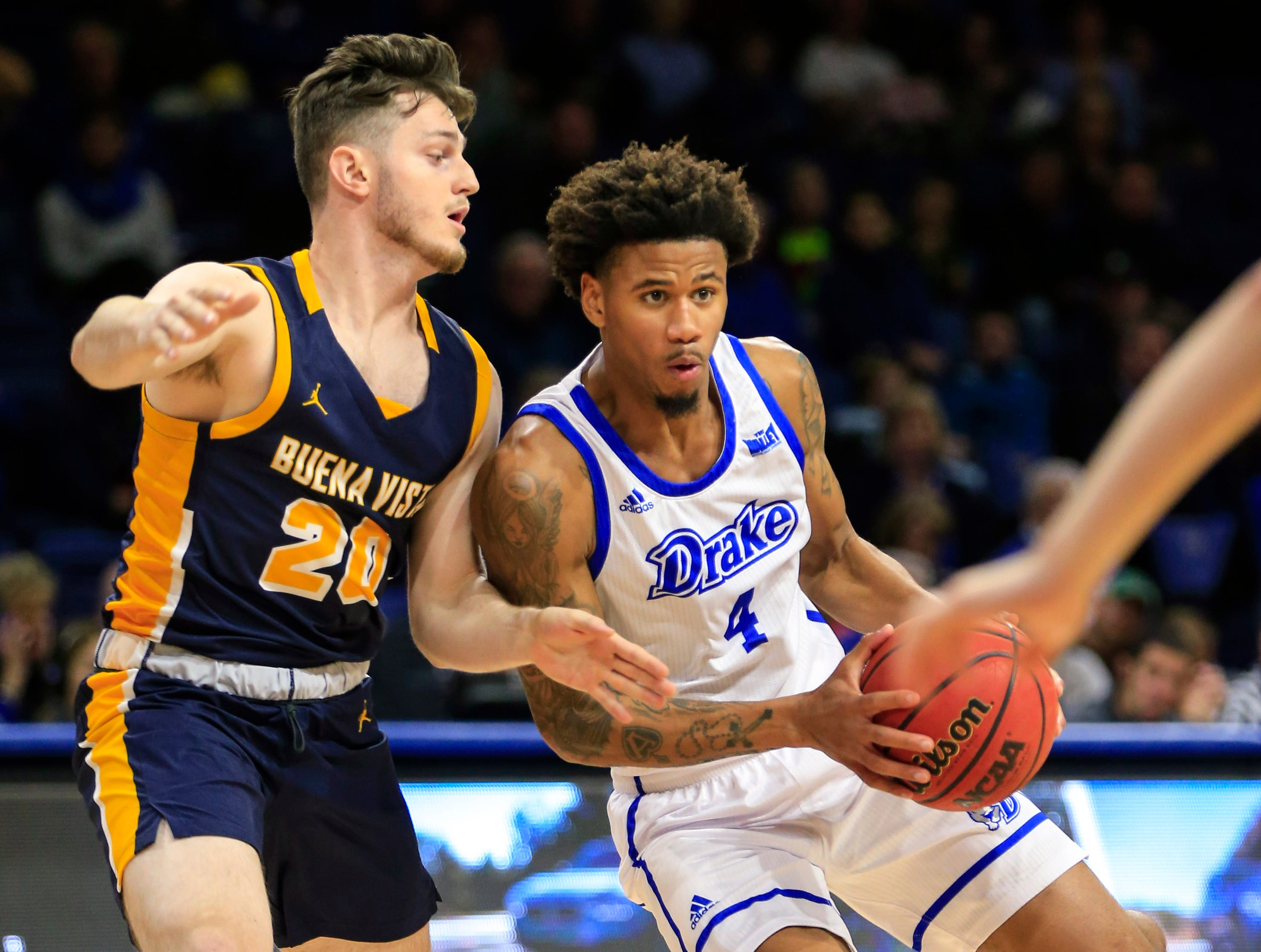 Anthony Murphy of Drake drives to the basket as Ryan Vogelei of Buena Vista defends during a game at the Knapp center Thursday, Nov. 8, 2018.
