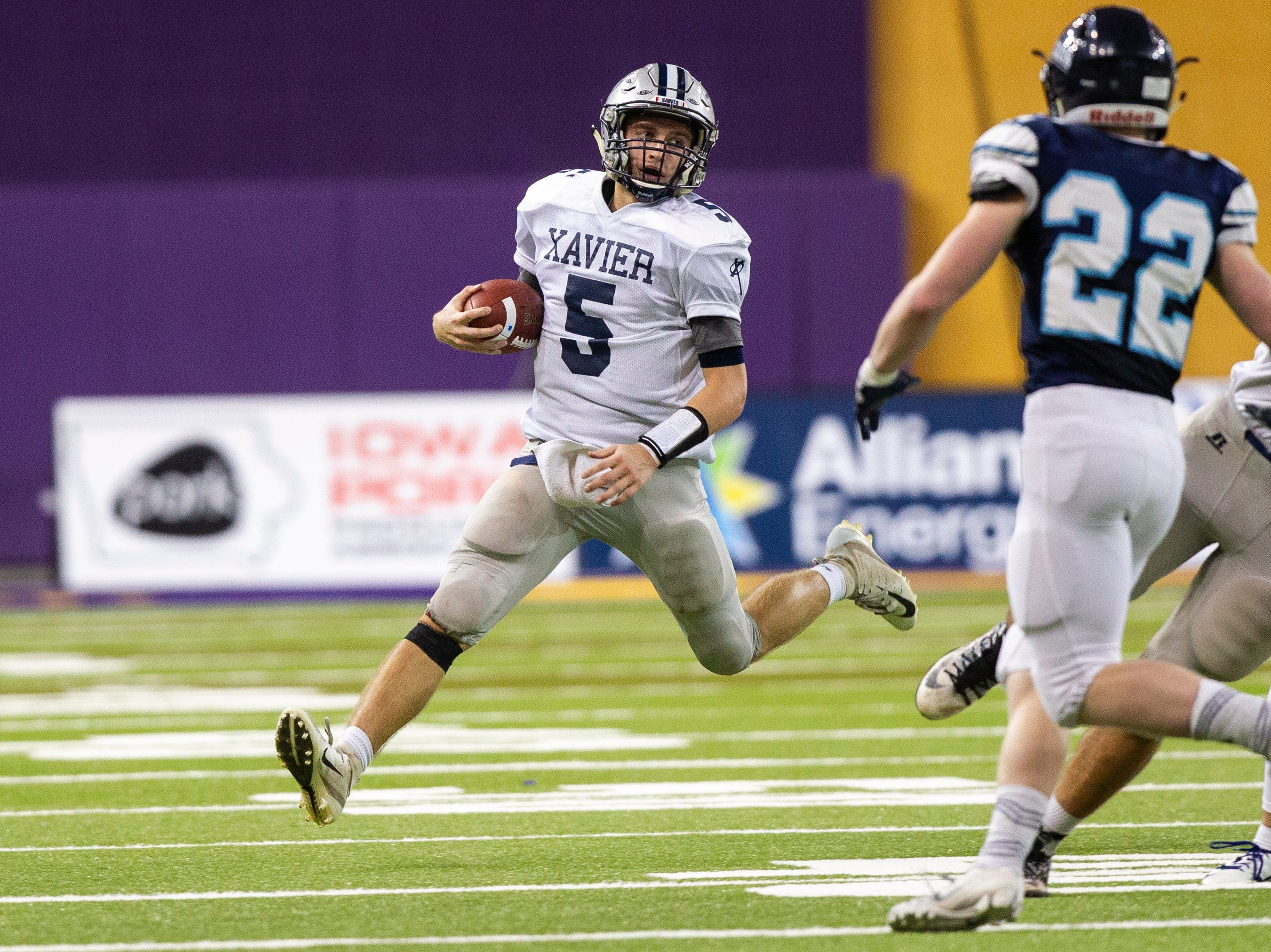 Cedar Rapids Xavier's Quinn Schulte (5) runs during a Class 3A semi finals on Thursday, Nov. 8, 2018, at the UNI-Dome in Cedar Falls.