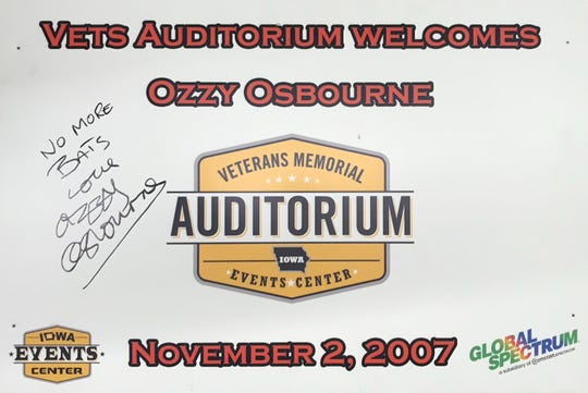 A poster signed by Ozzy Osbourne head of his Nov. 2, 2007, show at Veterans Memorial Auditorium, the venue where he bit the head off a bat in 1982.