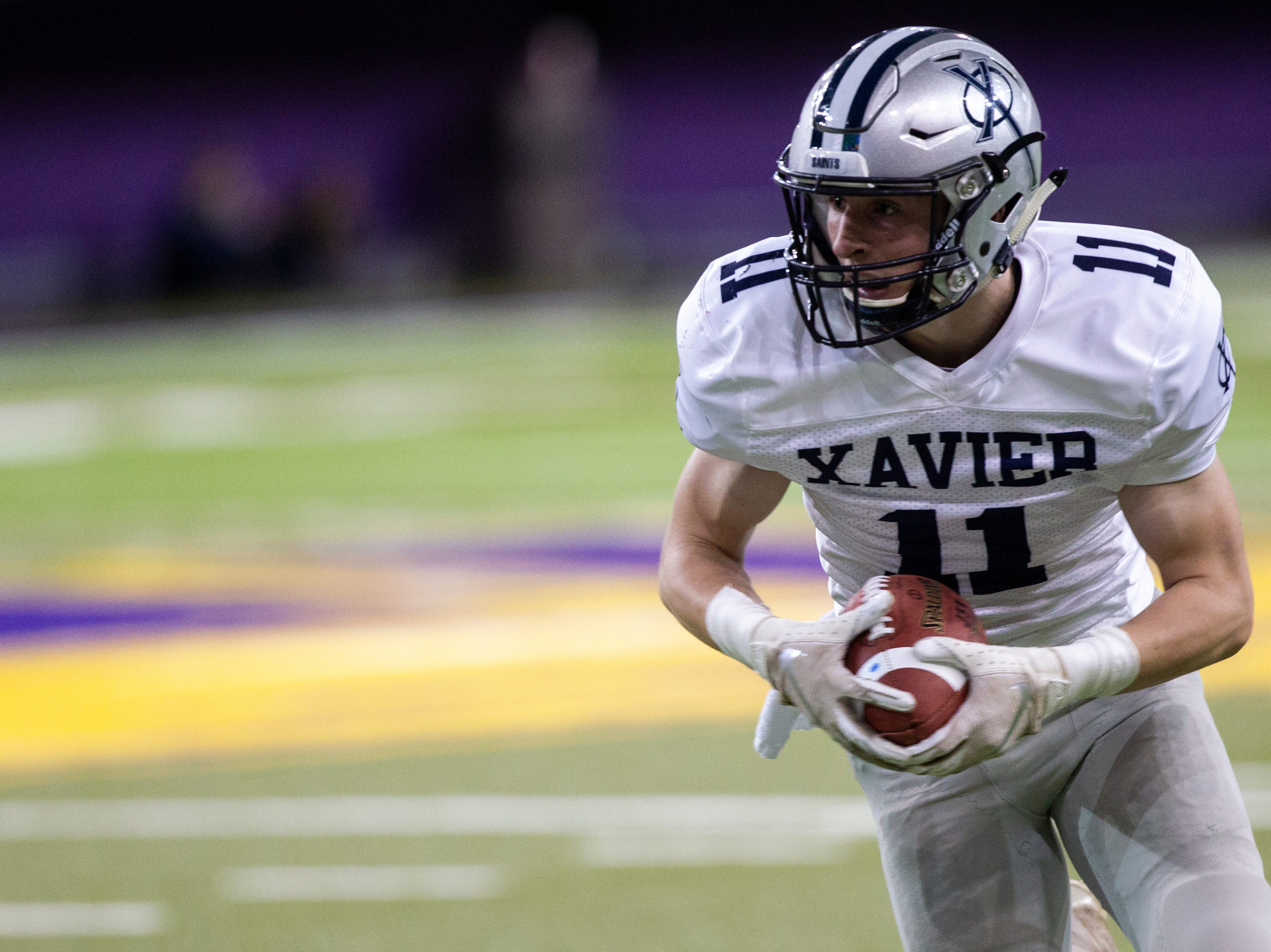 Cedar Rapids Xavier's Nick Banowetz (11) rushes during a Class 3A semi finals on Thursday, Nov. 8, 2018, at the UNI-Dome in Cedar Falls.