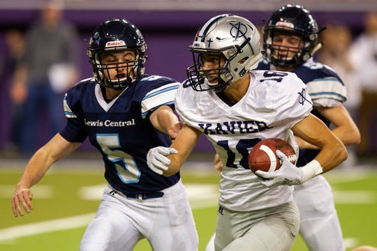 Lewis Central's Drake Nettles (5) tackles Cedar Rapids Xavier's Aaron Larson (18) during a Class 3A semi finals on Thursday, Nov. 8, 2018, at the UNI-Dome in Cedar Falls.