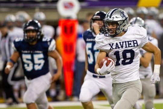 Cedar Rapids Xavier's Aaron Larson (18) returns a punt during a Class 3A semi finals on Thursday, Nov. 8, 2018, at the UNI-Dome in Cedar Falls.