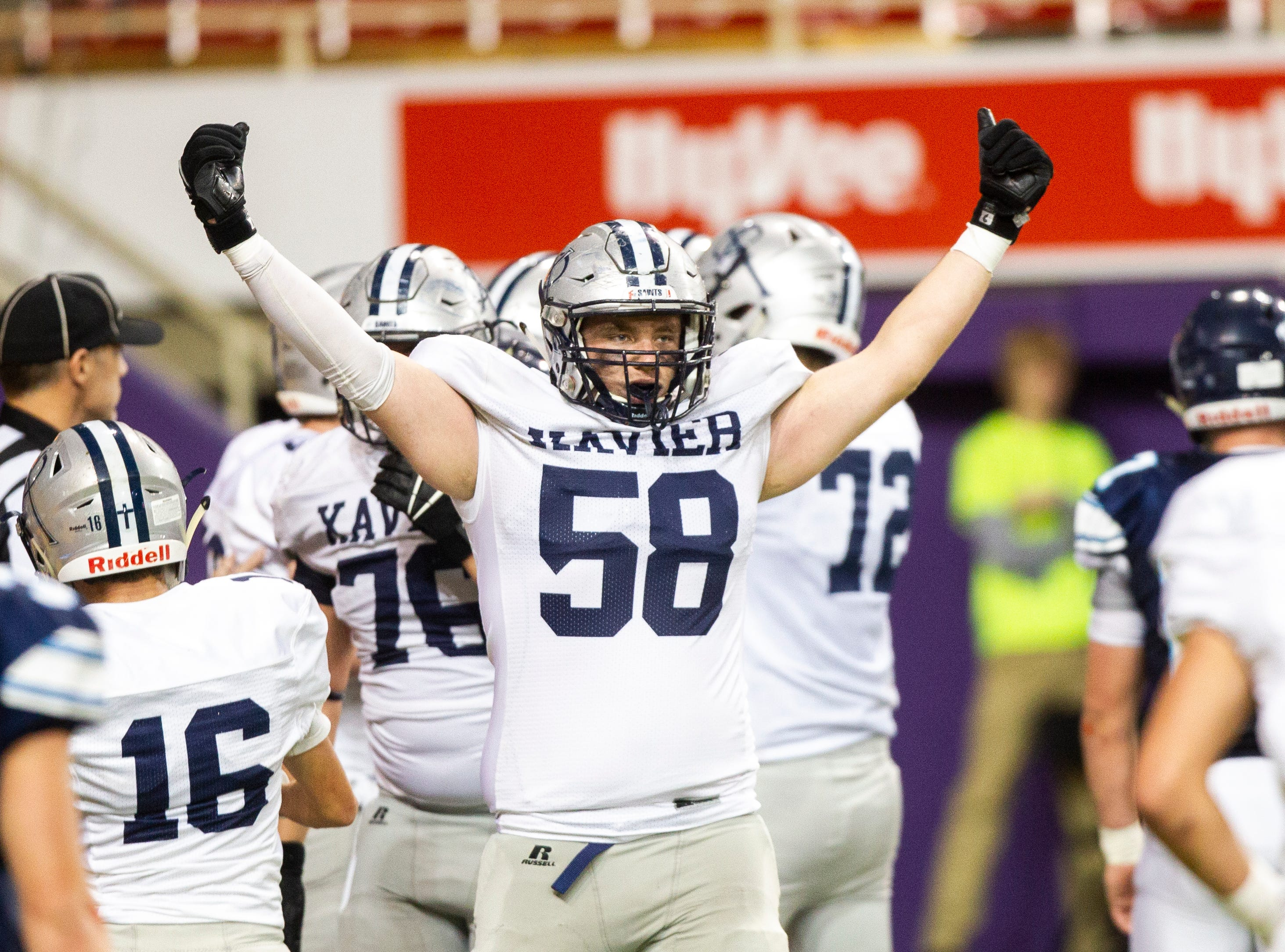 Cedar Rapids Xavier's Derrick Voss (58) celebrates after a touchdown during a Class 3A semi finals on Thursday, Nov. 8, 2018, at the UNI-Dome in Cedar Falls.