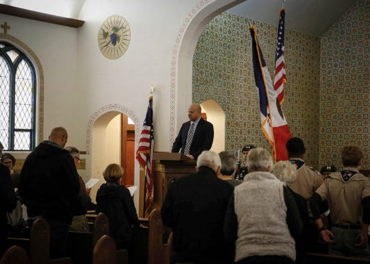 Matthew Harvey, head of the Fort Des Moines Museum and Education Center's board of directors, leads a worship service Nov. 3 at the museum.