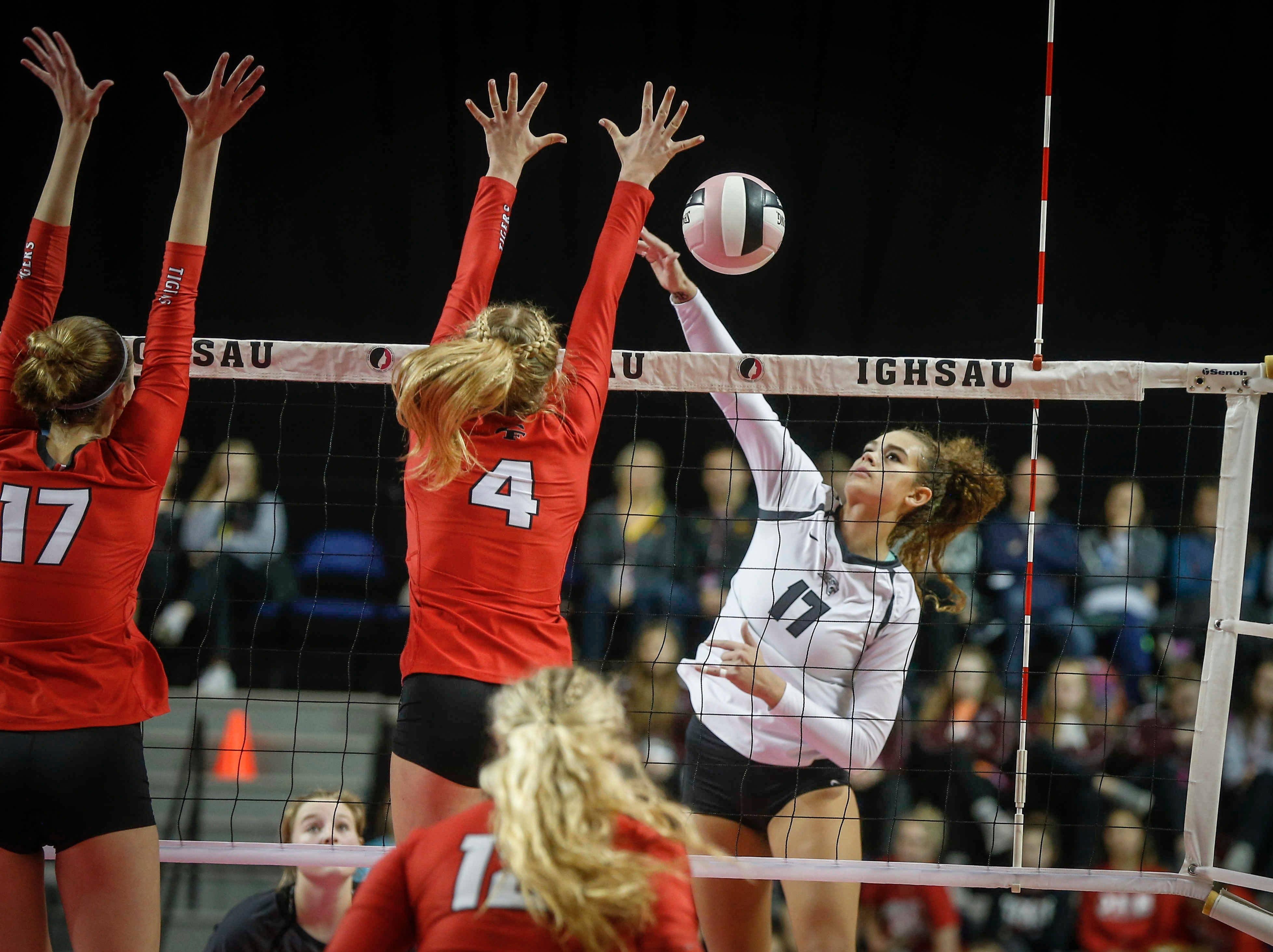 Ankeny Centennial's Ari Winters drills a shot over the net against Cedar Falls during the Class 5A state volleyball tournament championship game on Friday, Nov. 9, 2018, in Cedar Rapids.