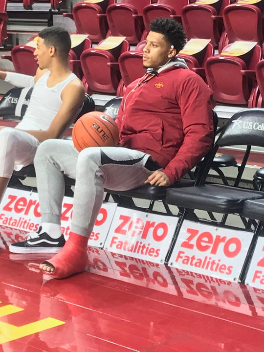 Injured Iowa State guard Lindell Wigginton sits on the bench before Friday's game.