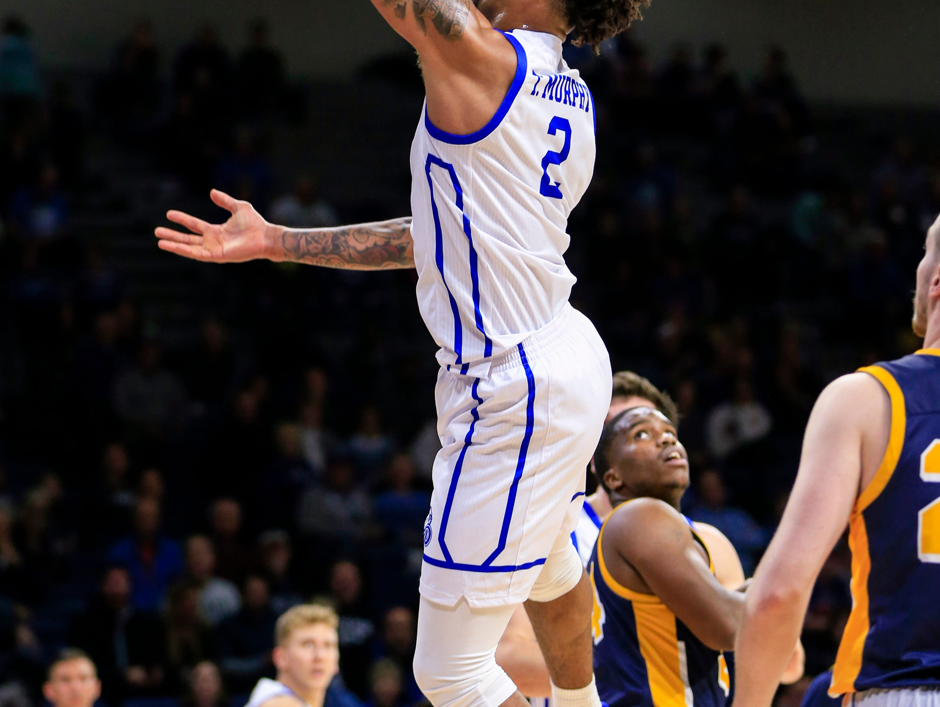 Drake's Tremell Murphy drives to the basket during a game against Buena Vista at the Knapp center Thursday, Nov. 8, 2018.