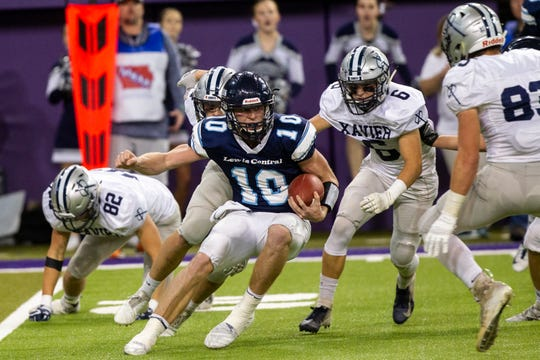 Lewis Central's Max Duggan (10) tries to evade a sack from Cedar Rapids Xavier's Bryson Bastian (6) during a Class 3A semifinals on Thursday, Nov. 8, 2018, at the UNI-Dome in Cedar Falls.
