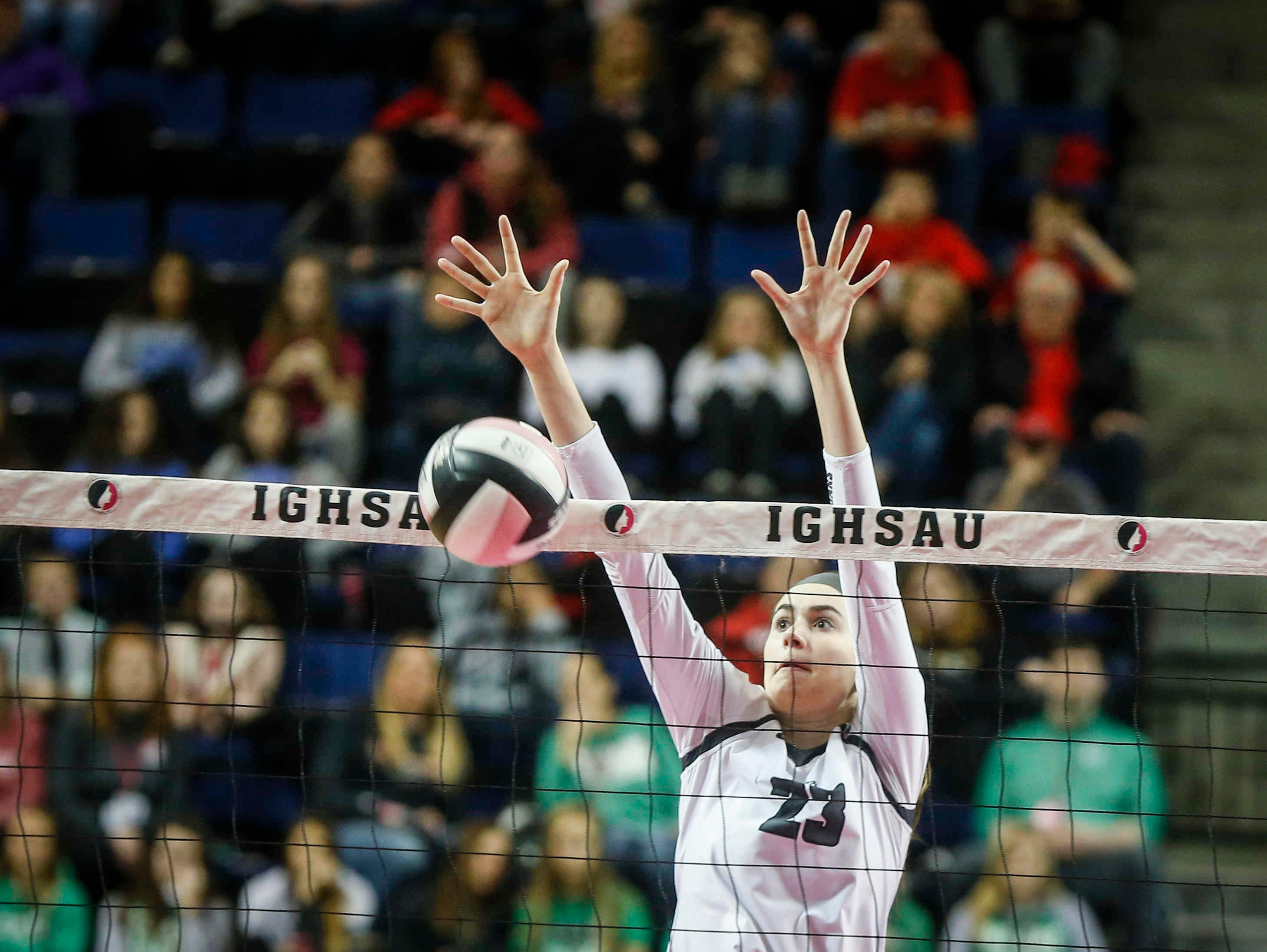 Ankeny Centennial's Megan Lively stops the ball at the net against Cedar Falls during the Class 5A state volleyball tournament championship game on Friday, Nov. 9, 2018, in Cedar Rapids.