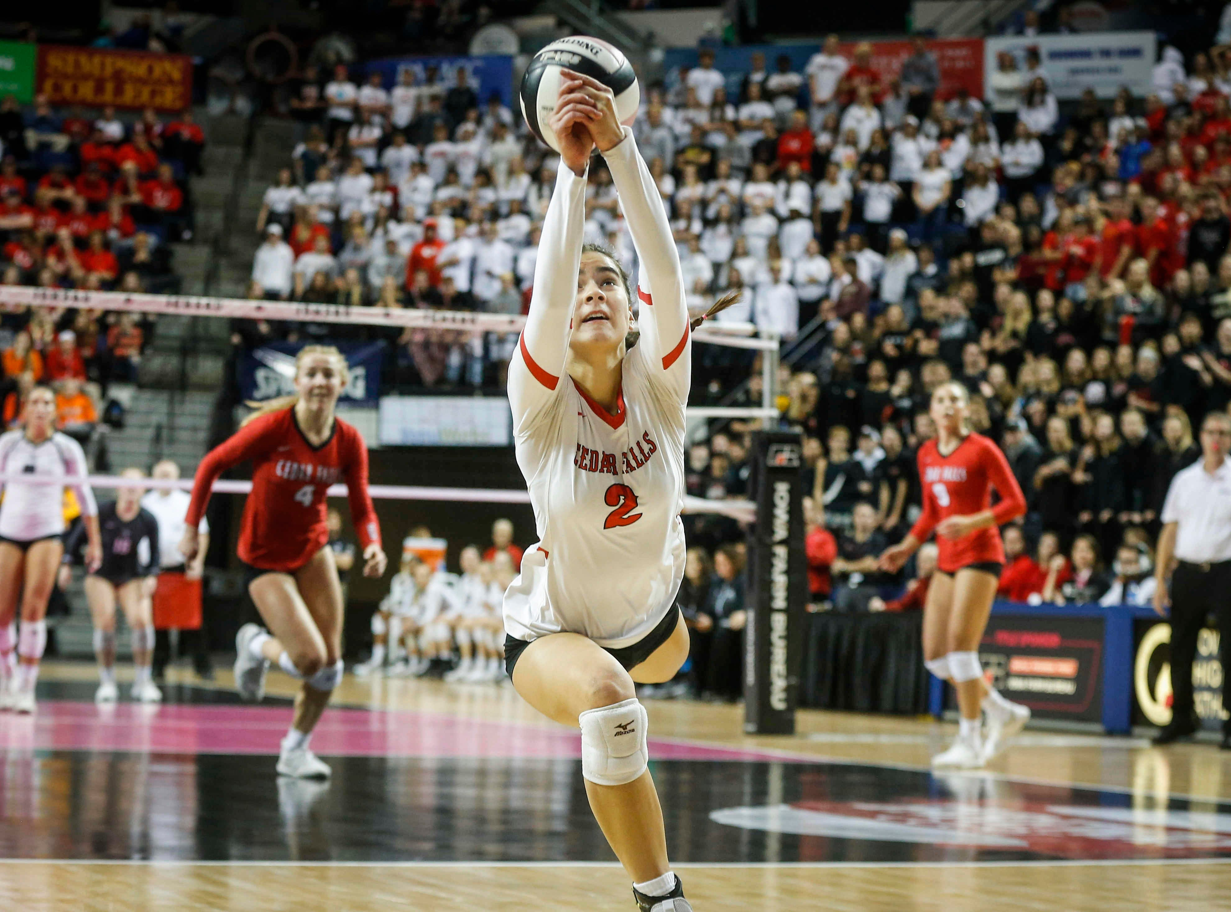 Cedar Falls' Kirsten Graves dives to save the ball against Ankeny Centennial during the Class 5A state volleyball tournament championship game on Friday, Nov. 9, 2018, in Cedar Rapids.