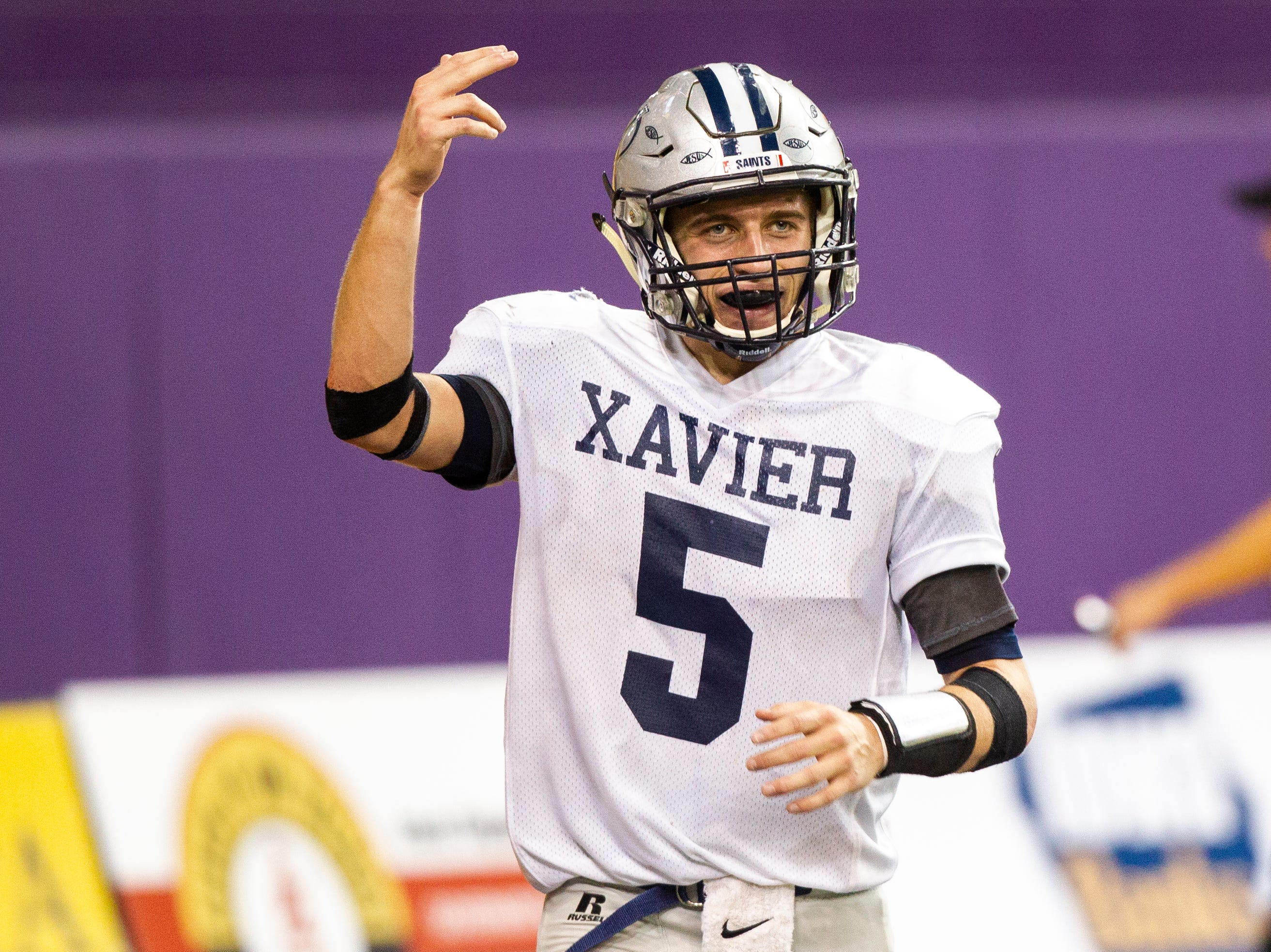 Cedar Rapids Xavier's Quinn Schulte (5) celebrates after scoring a touchdown on a quarterback sneak during a Class 3A semi finals on Thursday, Nov. 8, 2018, at the UNI-Dome in Cedar Falls.