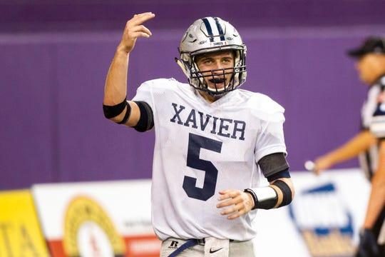 Cedar Rapids Xavier's Quinn Schulte (5) celebrates after scoring a touchdown on a quarterback sneak during a Class 3A semi finals on Thursday, Nov. 8, 2018, at the UNI-Dome in Cedar Falls.