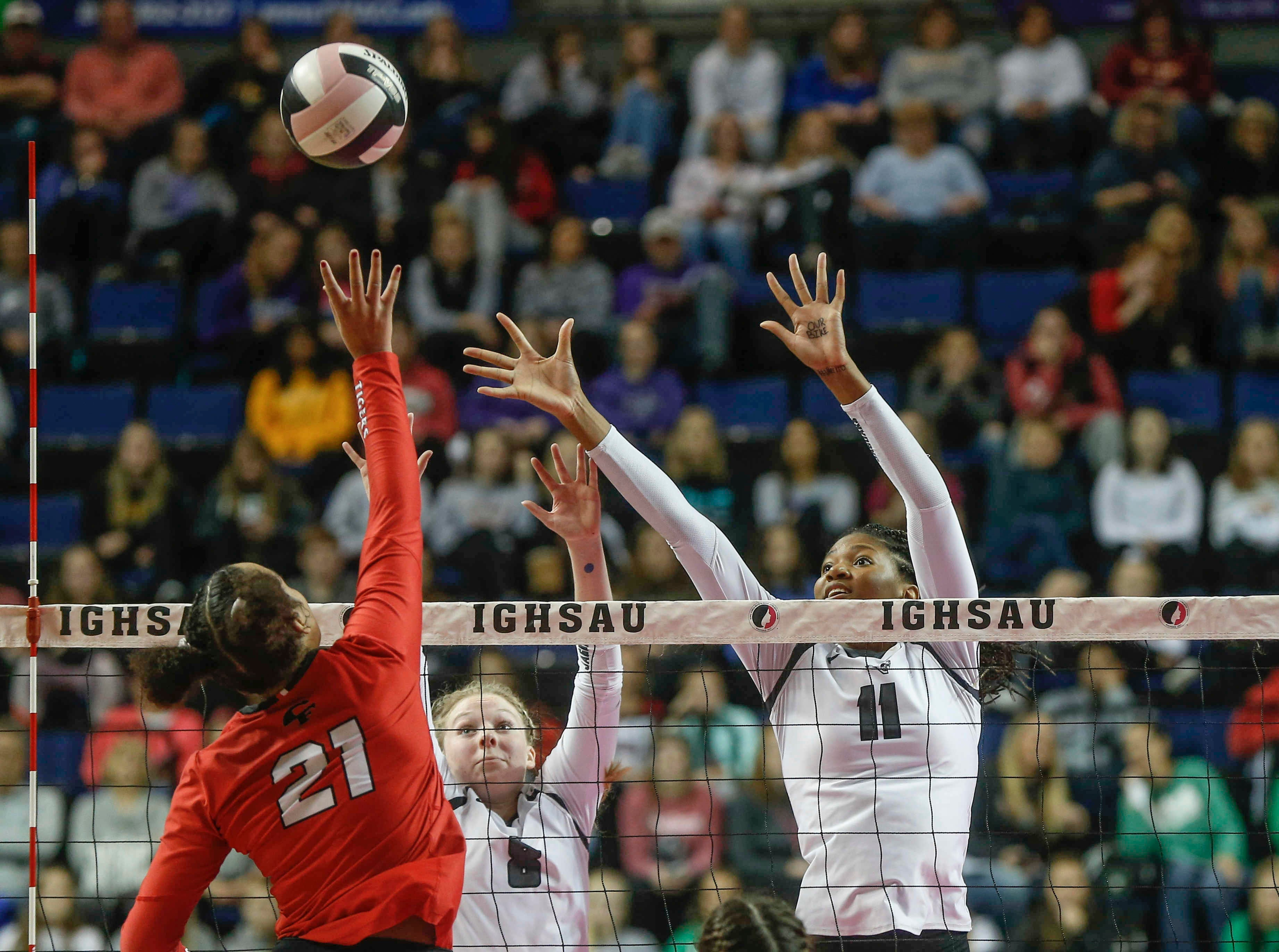Ankeny Centennial's Devyn Robinson stretches out to make a play on the ball against Cedar Falls during the Class 5A state volleyball tournament championship game on Friday, Nov. 9, 2018, in Cedar Rapids.