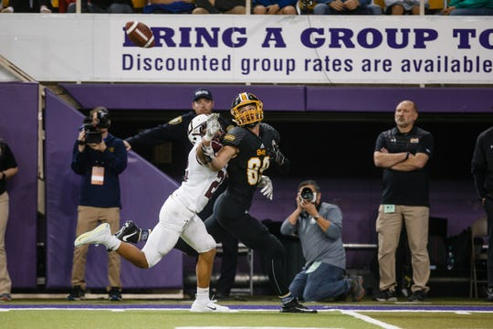 Bettendorf's Noah Abbott (89) looks back for a pass while being defended by Dowling Catholic's Owen Schiltz (22) during their 4A state football semi-final game on Friday, Nov. 9, 2018, in Cedar Falls. Bettendorf takes a 17-0 lead into halftime. The play was later called for pass interference.