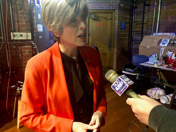 U.S. Sen. Joni Ernst answers questions from reporters following a town hall event in Ames.