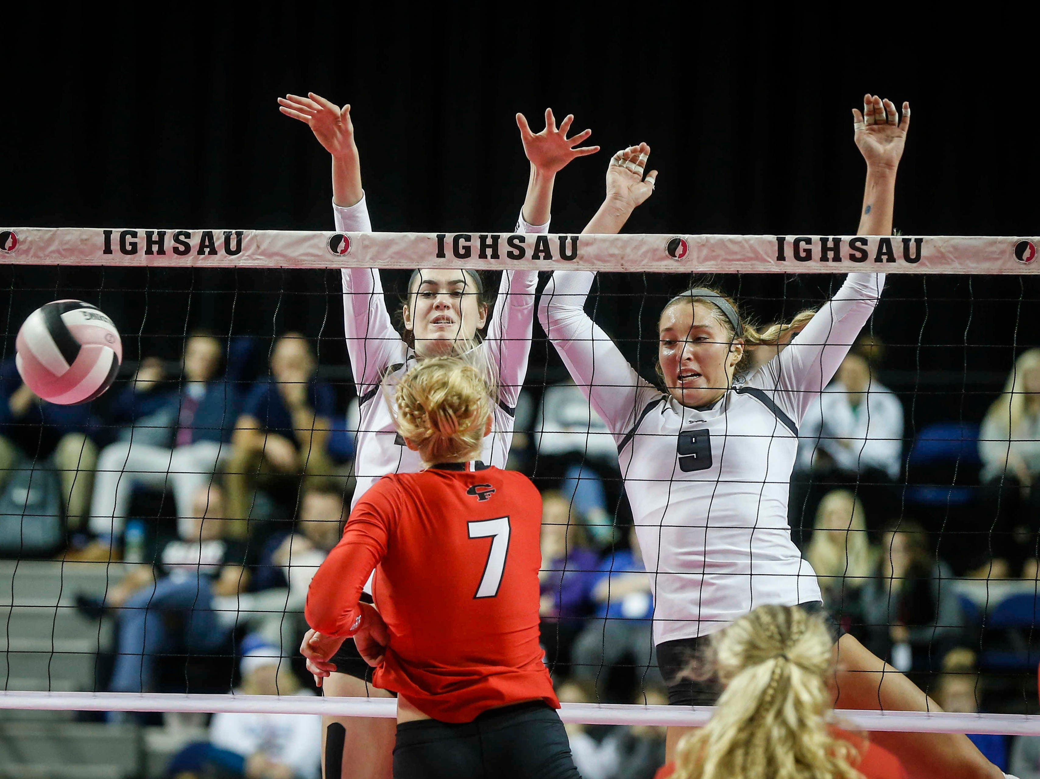 Ankeny Centennial's Megan Lively, left, and Kenna Sauer team up to stop a shot at the net against Cedar Falls during the Class 5A state volleyball tournament championship game on Friday, Nov. 9, 2018, in Cedar Rapids.