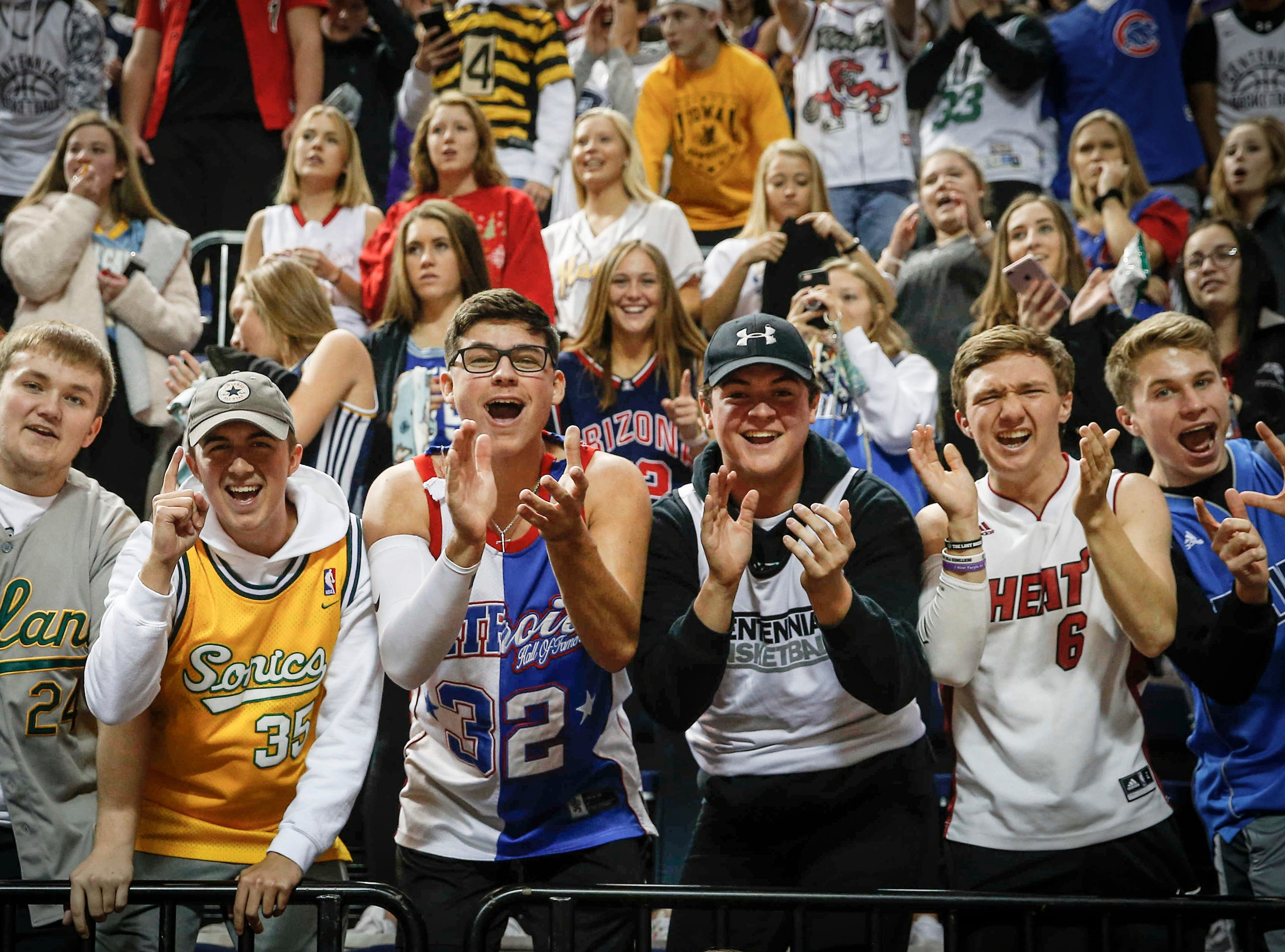 Ankeny Centennial student fans celebrate after the Jaguars volleyball team won a straight set Class 5A state title against Cedar Falls on Friday, Nov. 9, 2018, in Cedar Rapids.
