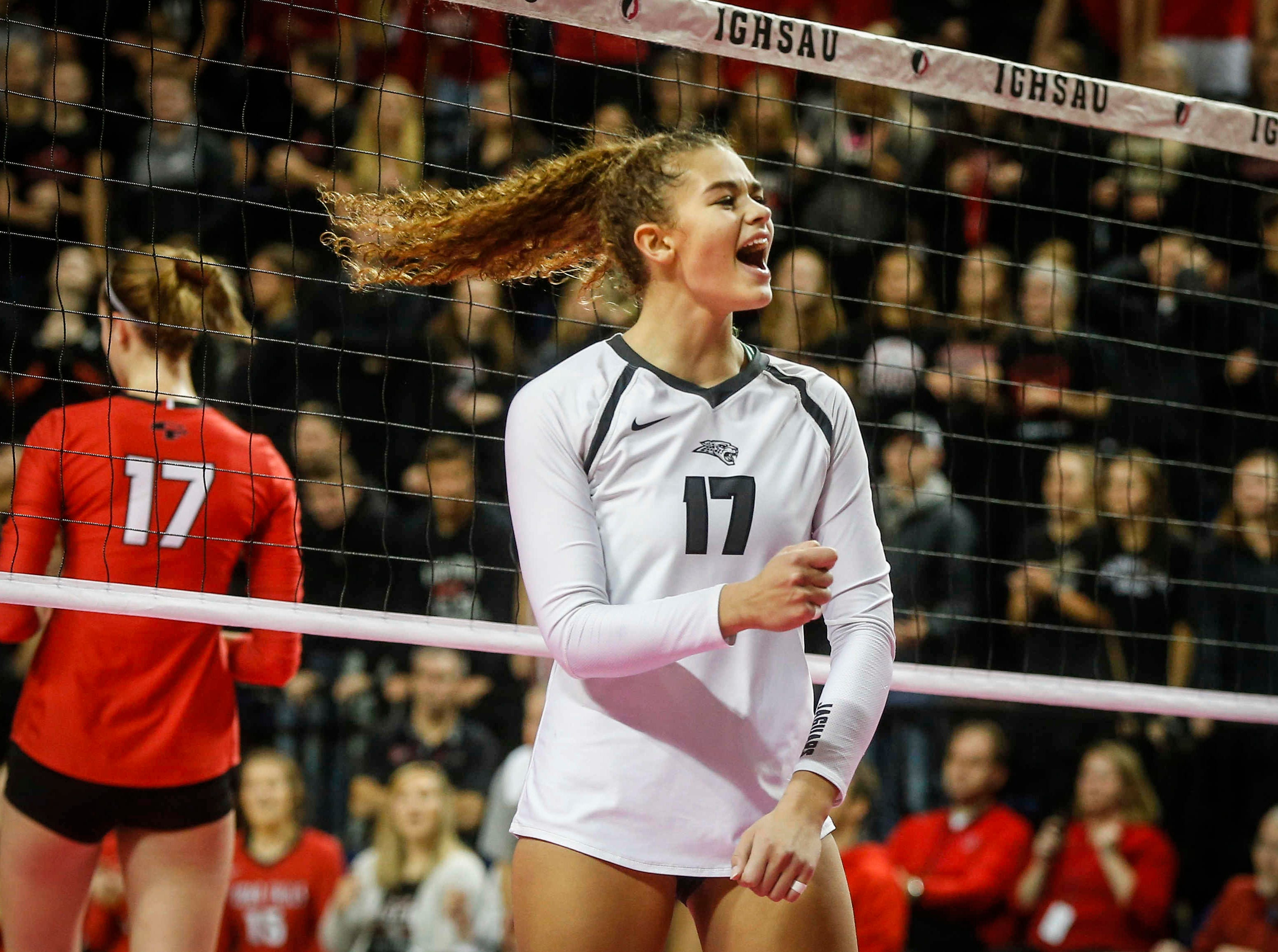 Ankeny Centennial's Ari Winters reacts after scoring a point against Cedar Falls during the Class 5A state volleyball tournament championship game on Friday, Nov. 9, 2018, in Cedar Rapids.