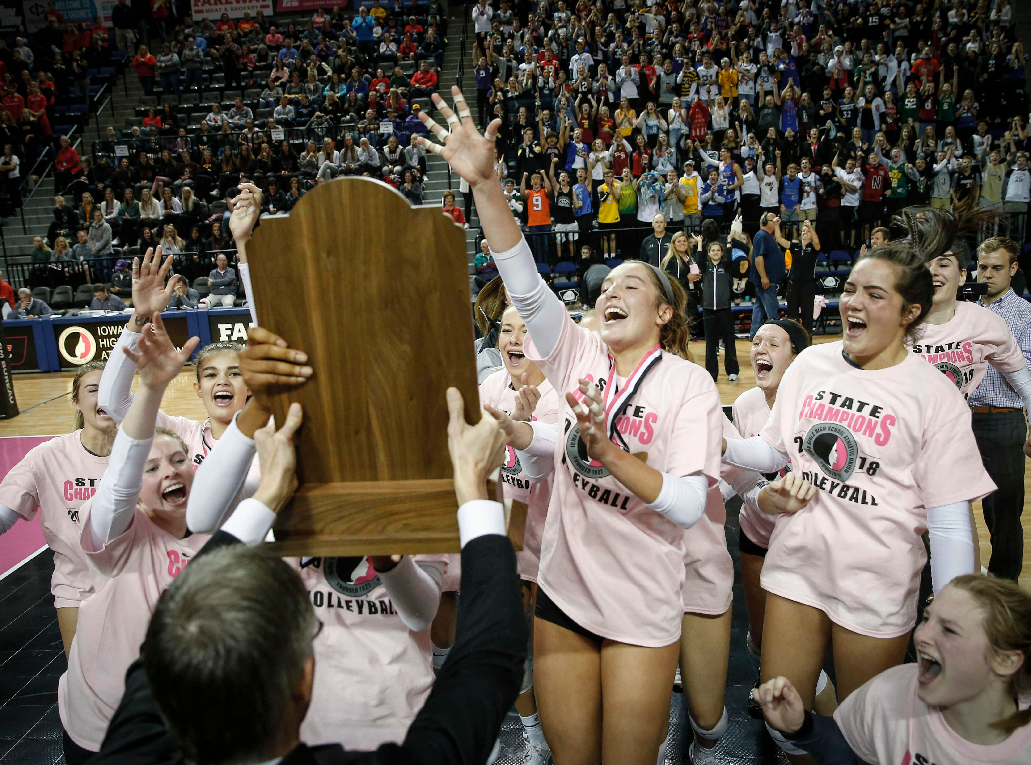 Members of the Ankeny Centennial volleyball celebrate after a straight set sweep of Cedar Falls for the Class 5A state championship on Friday, Nov. 9, 2018, in Cedar Rapids.