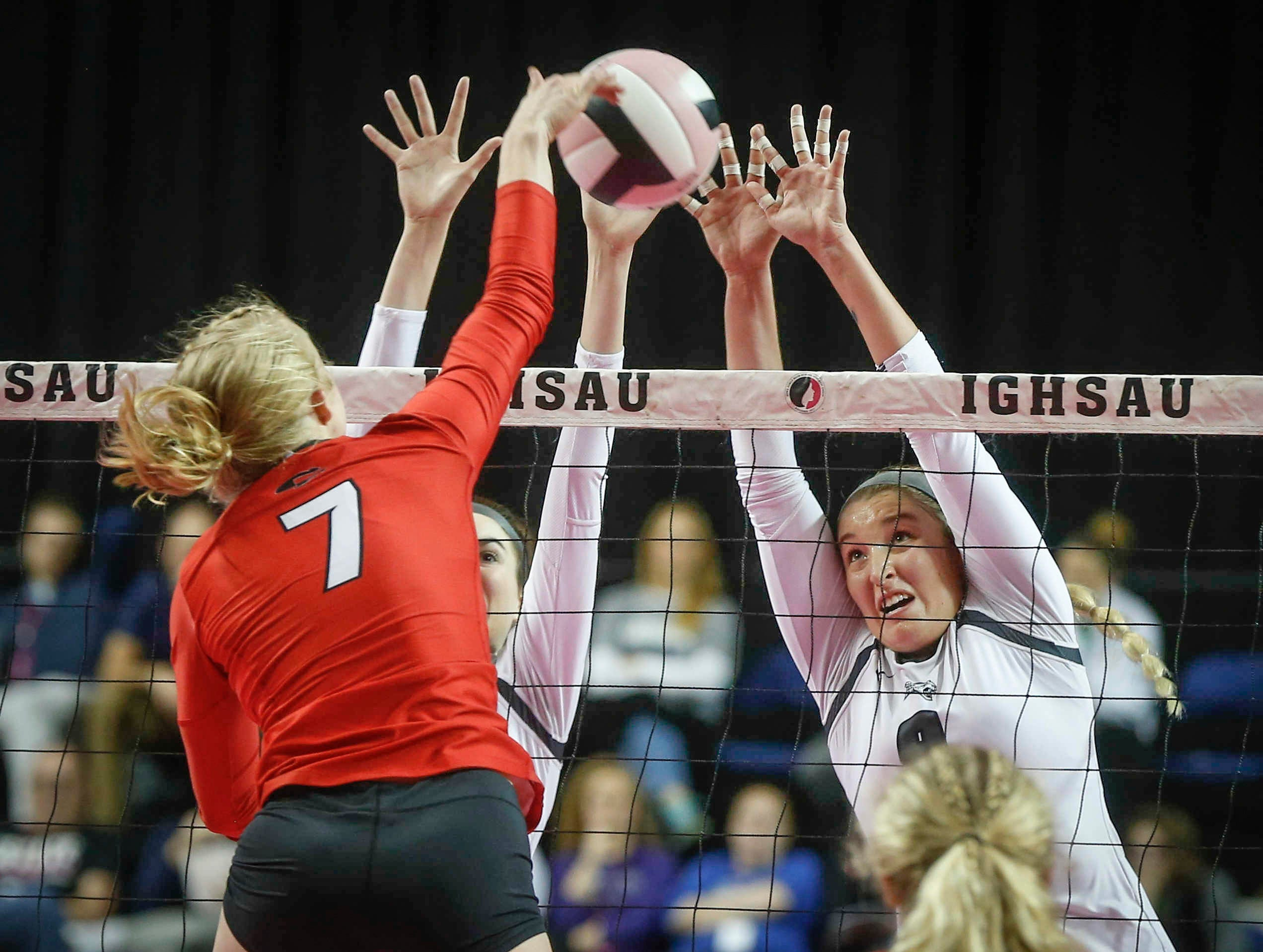 Ankeny Centennial's Kenna Sauer, right, blocks a shot at the net against Cedar Falls during the Class 5A state volleyball tournament championship game on Friday, Nov. 9, 2018, in Cedar Rapids.