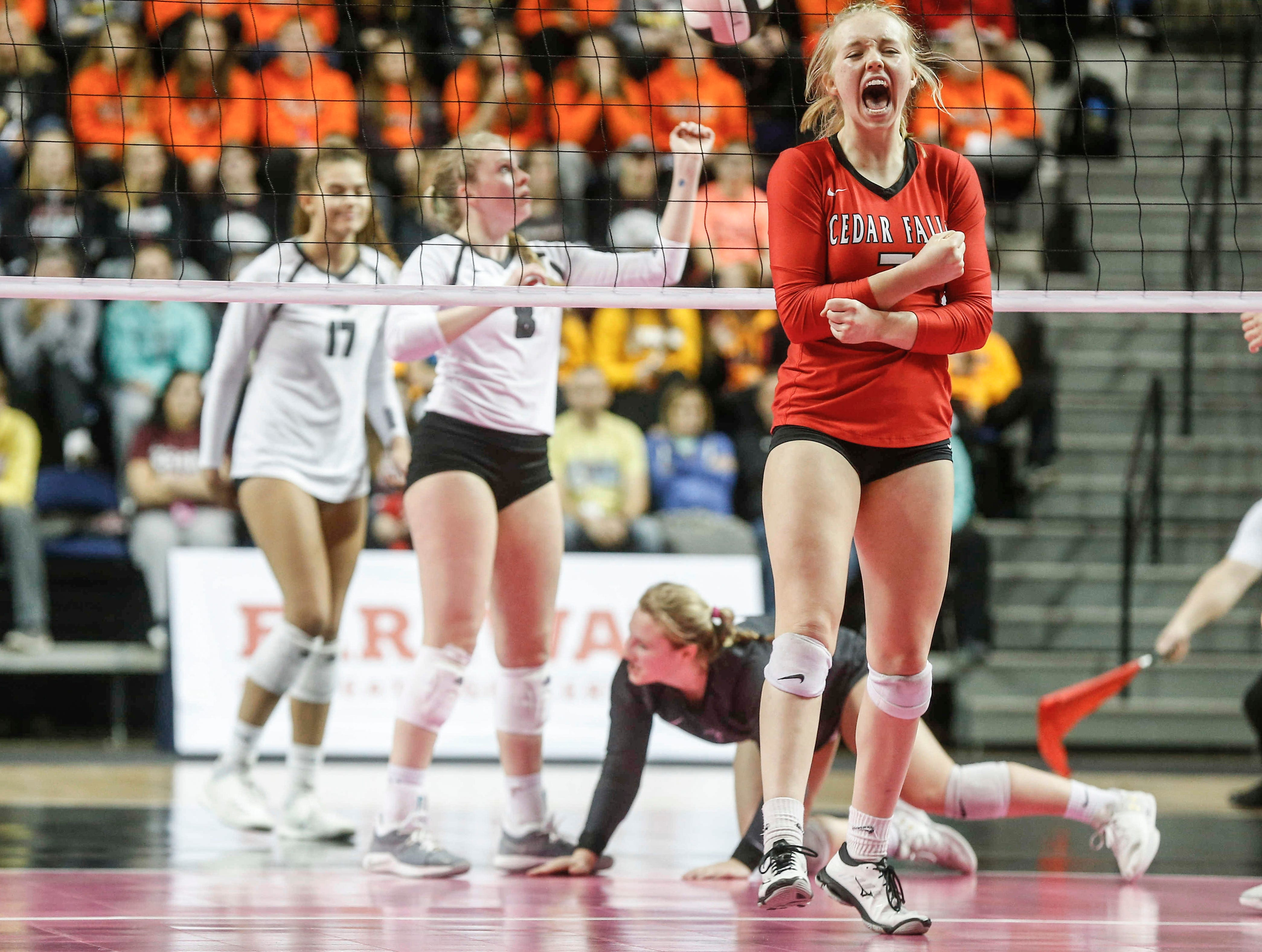 Cedar Falls' Dara Hulstein reacts after scoring a point against Ankeny Centennial during the Class 5A state volleyball tournament championship game on Friday, Nov. 9, 2018, in Cedar Rapids.