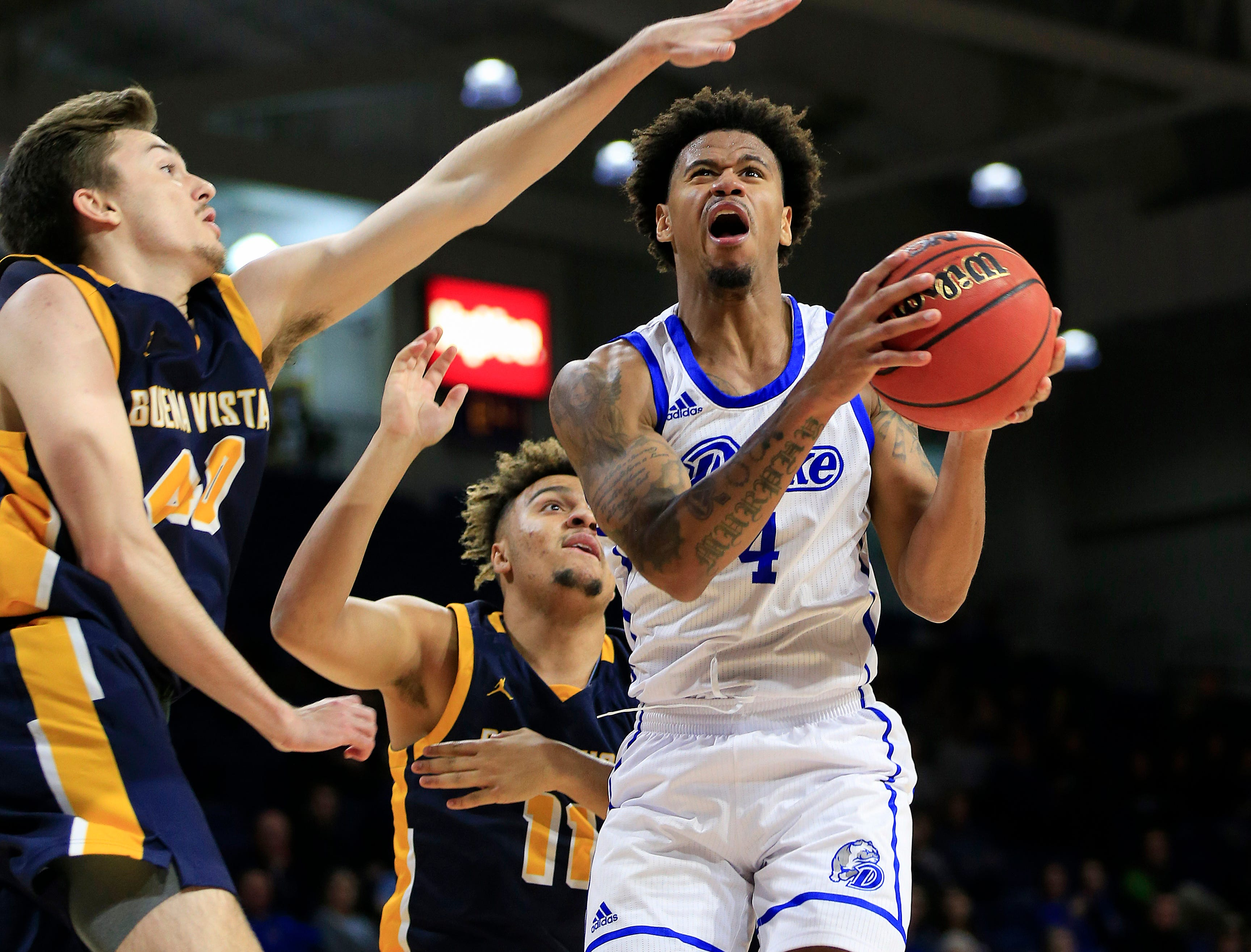 Anthony Murphy of Drake drives to the basket during a game against Buena Vista at the Knapp center Thursday, Nov. 8, 2018.