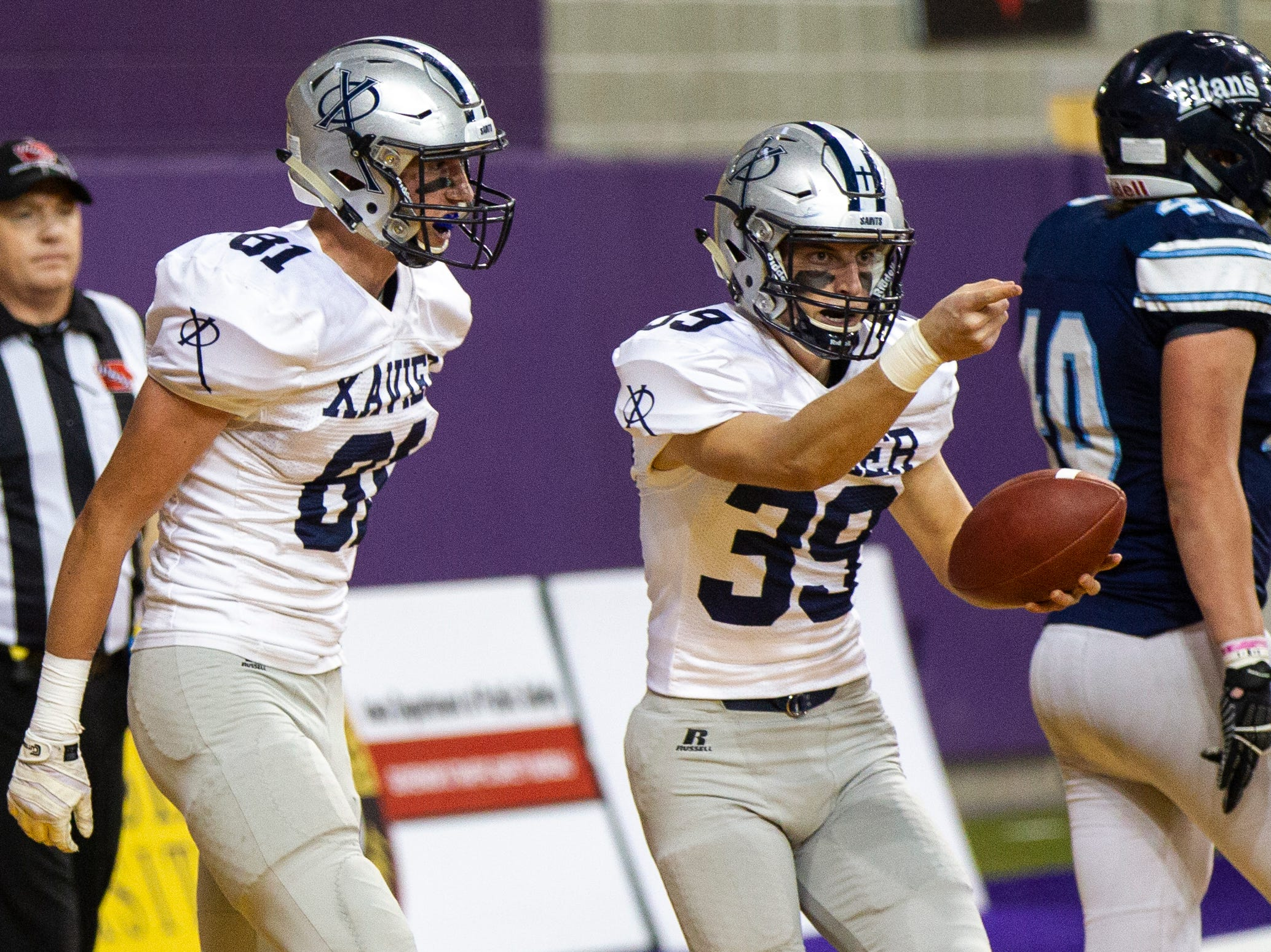 Cedar Rapids Xavier's Mitch Willey (39) celebrates after catching a touchdown during a Class 3A semi finals on Thursday, Nov. 8, 2018, at the UNI-Dome in Cedar Falls.