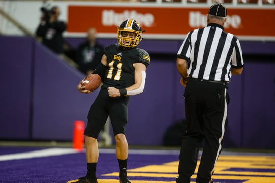 Bettendorf's Carter Bell (11) rushes in for a touchdown during their 4A state football semi-final game on Friday, Nov. 9, 2018, in Cedar Falls. Bettendorf takes a 17-0 lead into halftime.