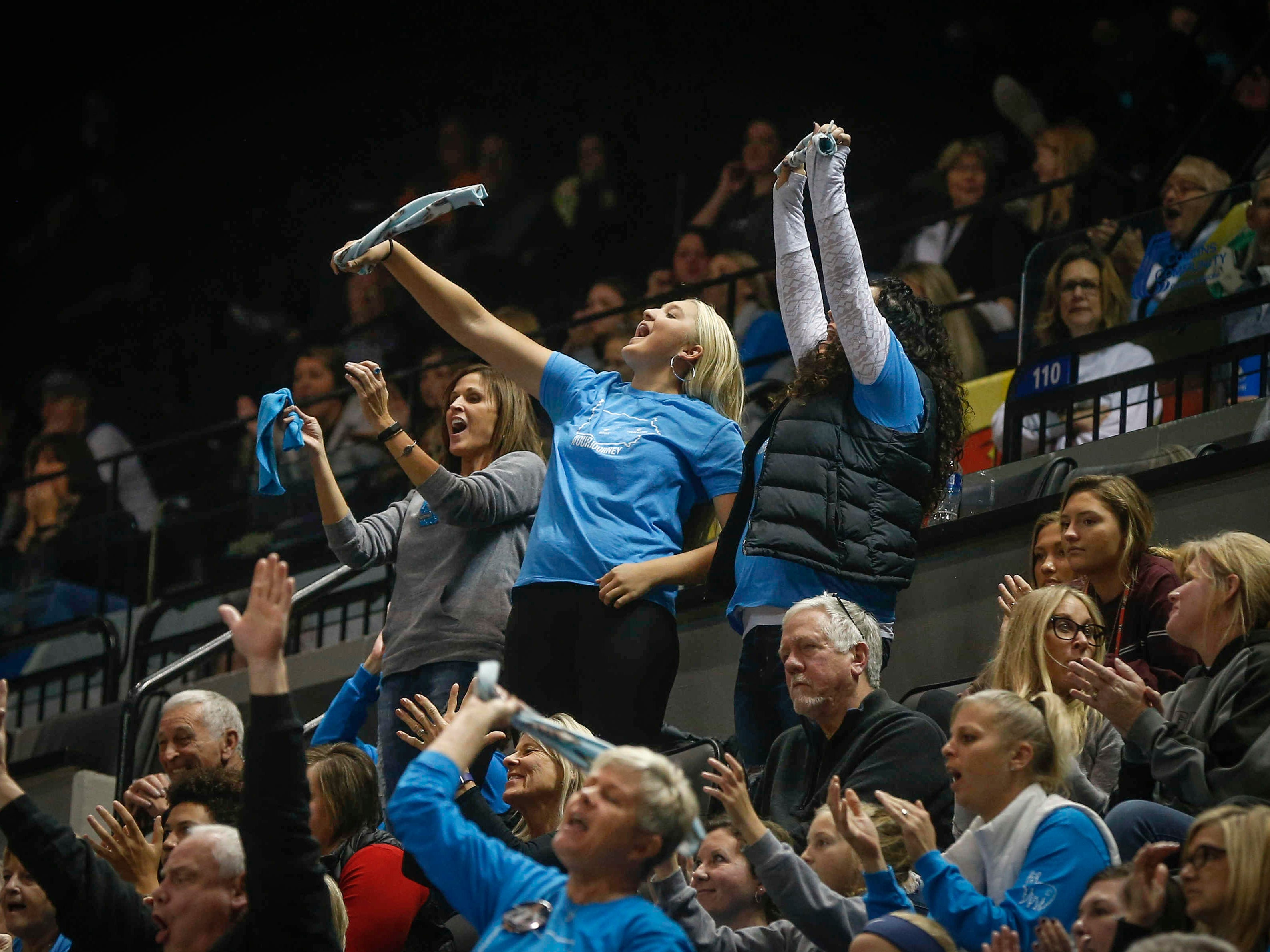 Ankeny Centennial fans celebrate a point against Cedar Falls during the Class 5A state volleyball tournament championship game on Friday, Nov. 9, 2018, in Cedar Rapids.
