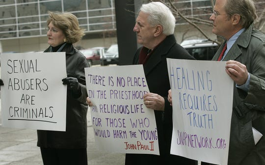 Paul Koeniguer, center, protests the cover-up of sexual abuse by the Catholic Church in this 2006 demonstration in Des Moines. Koeniguer is a members of the Survivors Network of those Abused by Priests.