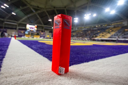An Iowa High School Athletic Association logo is seen on an endzone pylon during a Class 3A semi finals on Thursday, Nov. 8, 2018, at the UNI-Dome in Cedar Falls.