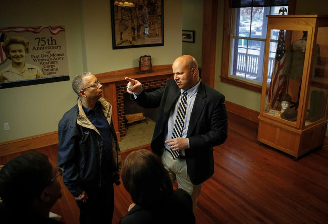 Matthew Harvey, right, head of the Fort Des Moines Museum and Education Center's board of directors, gives a tour of the museum to William Spriggs of Washington, D.C., on Nov. 3.