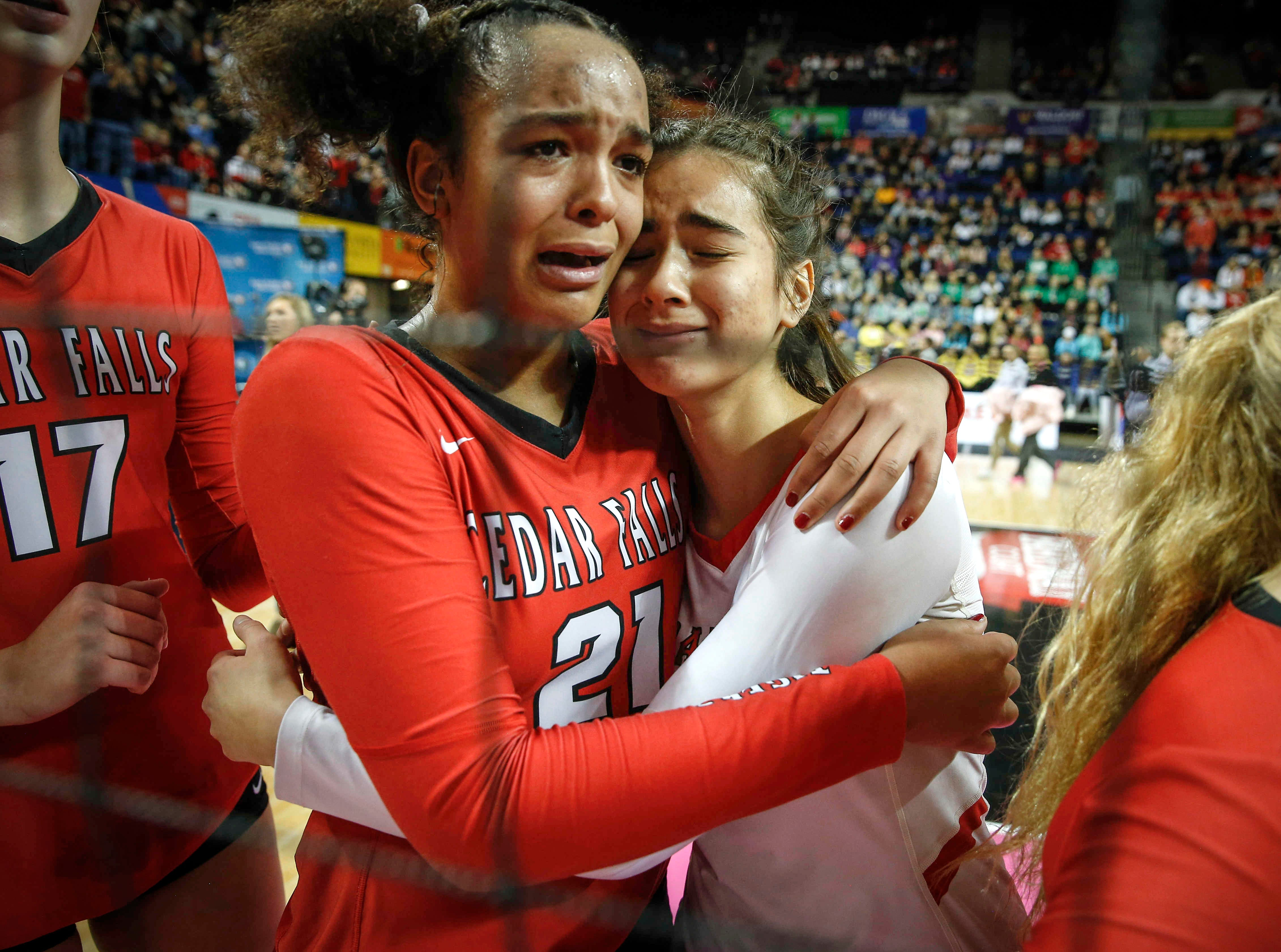 Cedar Falls' Akacia Brown, left, hugs Kirsten Graves after the Tigers lost to Ankeny Centennial during the Class 5A state volleyball tournament championship game on Friday, Nov. 9, 2018, in Cedar Rapids.
