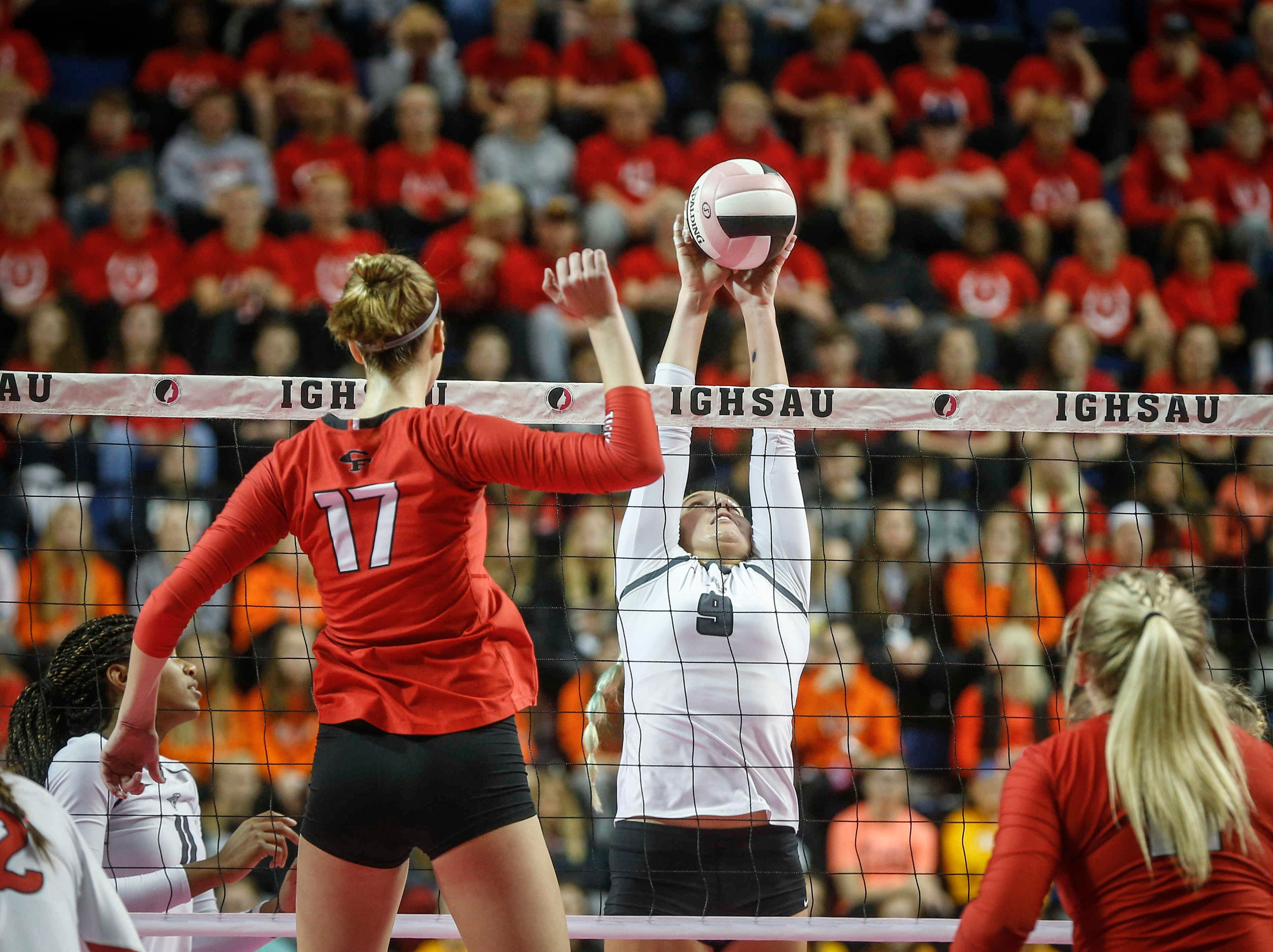 Ankeny Centennial's Kenna Sauer stops the ball at the net against Cedar Falls during the Class 5A state volleyball tournament championship game on Friday, Nov. 9, 2018, in Cedar Rapids.
