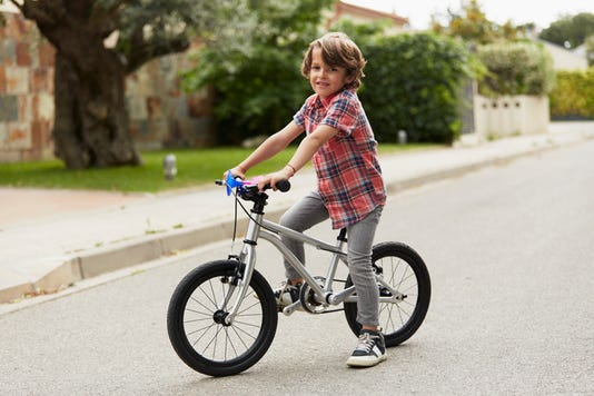 Confident Boy Sitting On Bicycle