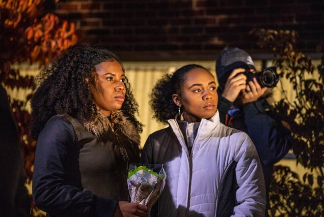 Central Michigan University sophomores Yasmeen Duncan (left) and Rebecca Rose watch people speak during the CMU chapter of the NAACP's protest on Thursday, Nov. 8, 2018, after a racist message was written on their dorm room door.