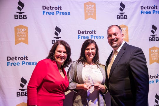 Edward Jones wins first place in large size company category during 2018 Top Workplaces awards ceremony at the Royal Oak Music Theatre in Royal Oak, Nov. 8, 2018. Presenters are Melanie Duquesnel, president and CEO of BBB of Detroit and Eastern Michigan, left, and  Tim Gruber, Detroit Free Press and Michigan.com president.