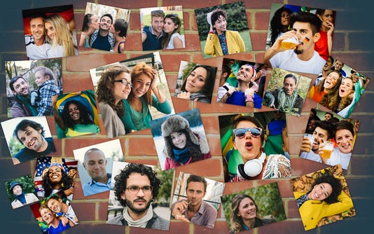 Many People Portrait On A Brick Wall