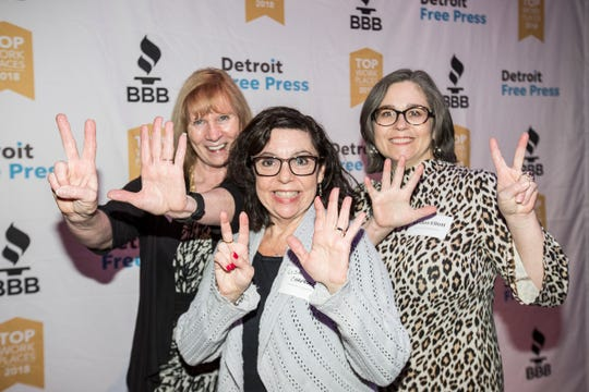From left, Marylynn Hewitt, Lisa Chapman, and Kirsten Elliott of Community Housing Network pose for a photo during 2018 Top Workplaces awards ceremony at the Royal Oak Music Theatre in Royal Oak, Nov. 8, 2018.