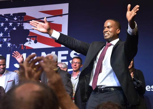 Republican Senate candidate John James blows a kiss to his supporters at his primary election night party at James Group International in Detroit on Aug. 7.