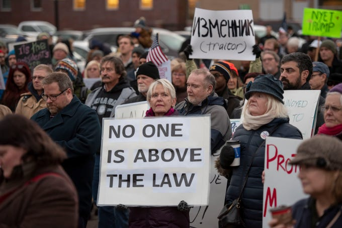 People hold signs during a rally at Ferndale City Hall on Thursday, November 8, 2018 to demand that Special Counsel Robert Mueller's investigation be protected in the wake of the firing of U.S. Attorney General Jeff Sessions.