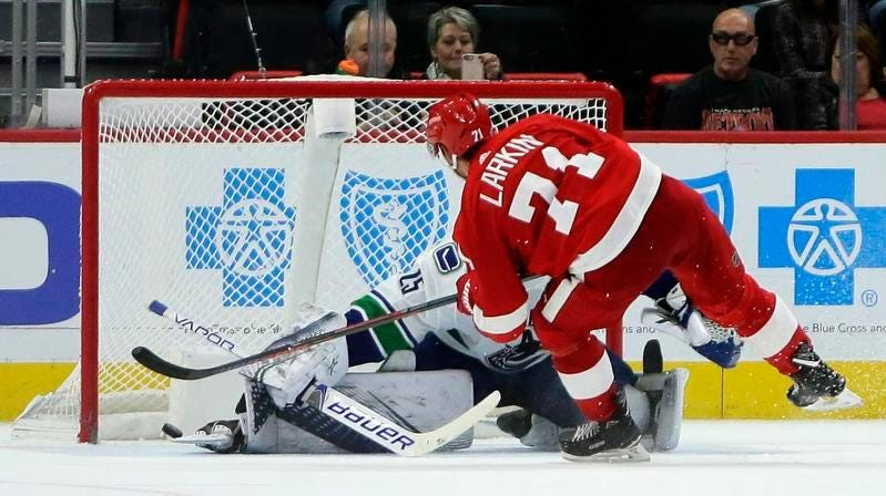 Red Wings forward Dylan Larkin scores a goal in Tuesday's shootout victory against