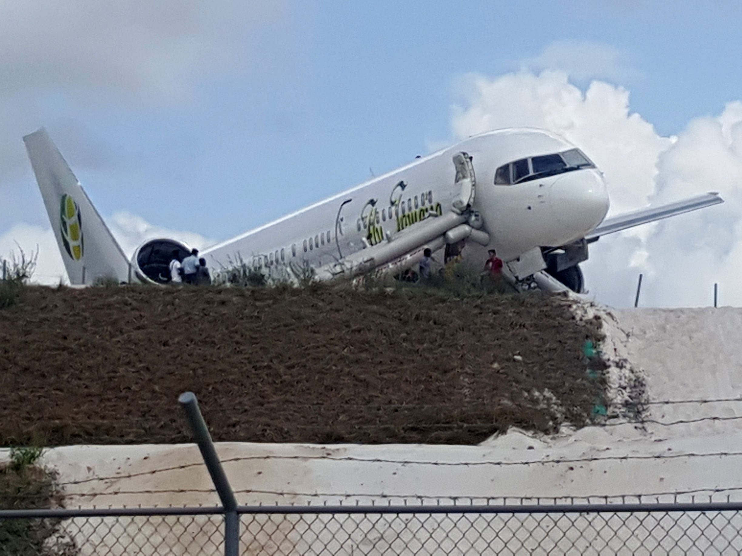 A Toronto-bound Fly Jamaica airplane is seen after crash-landing at the Cheddi Jagan International Airport in Georgetown, Guyana on November 9, 2018. - A Boeing jetliner carrying 126 people crash-landed at the airport in Guyana's capital Georgetown on Friday, injuring six people, the transport minister said.