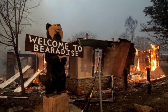 Flames consume a building as the Camp Fire tears through Paradise, Calif., on Thursday, Nov. 8, 2018.