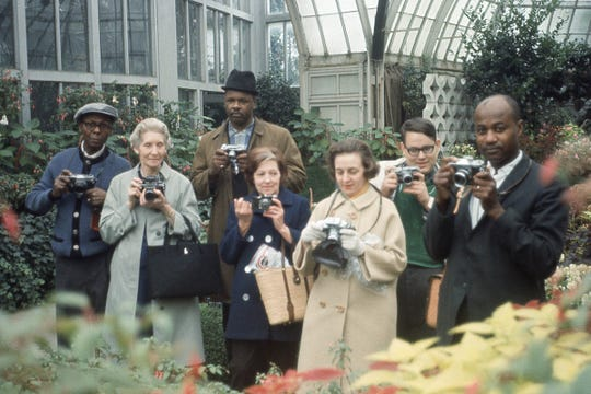 """Untitled (Group Portrait with Cameras, Belle Isle Conservatory, Detroit),"" around 1970, attributed to Allen Stross at the Detroit Institute of Arts."