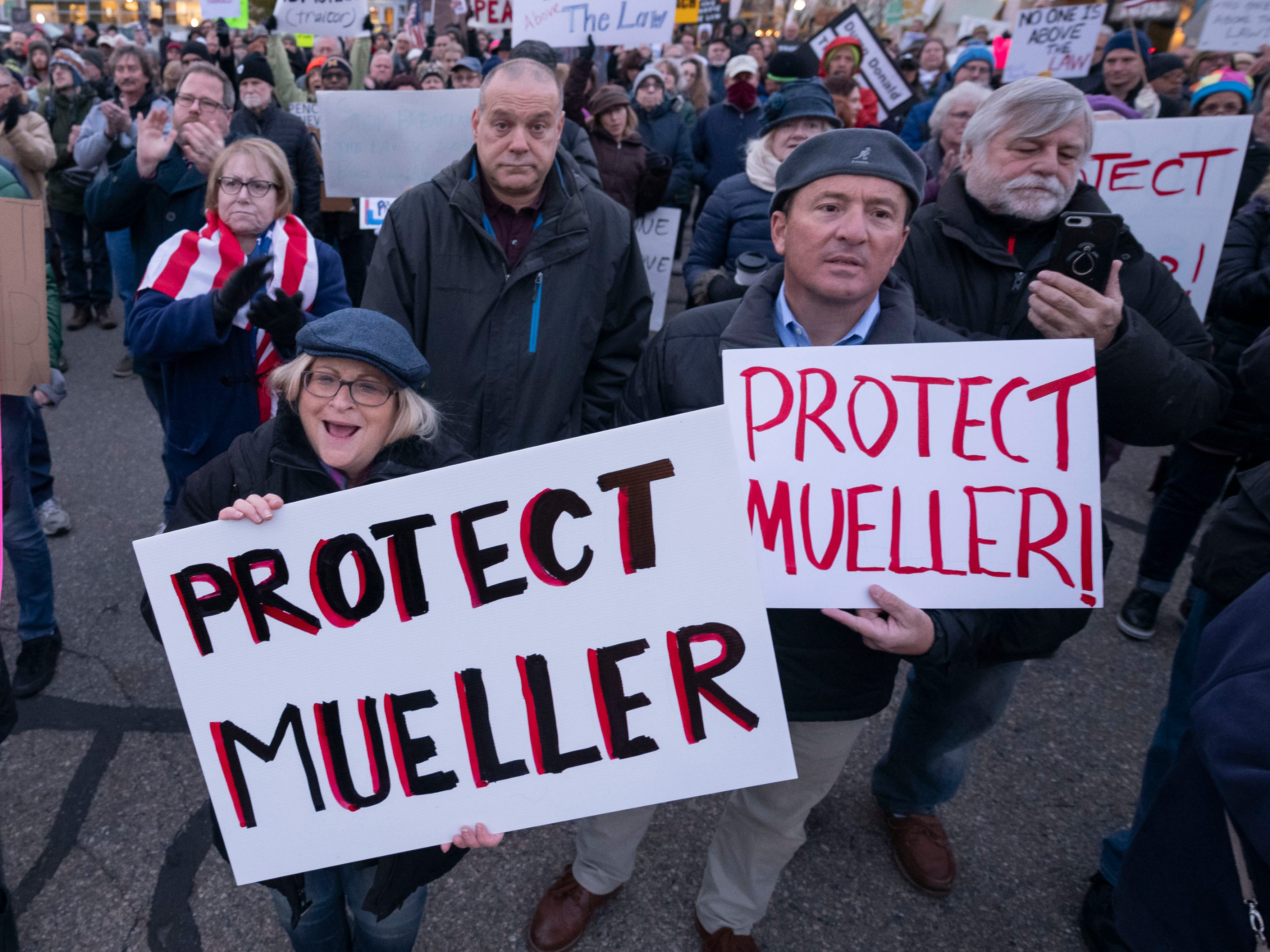 Hundreds of protesters hold signs and chant during a rally at Ferndale City Hall to demand that Special Counsel Robert Mueller's investigation be protected in the wake of the firing of U.S. Attorney General Jeff Sessions.